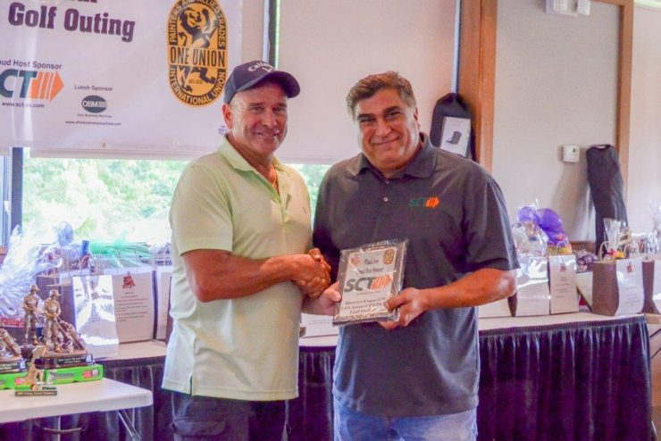 Joe Ventura, President of SCT (right) accepts thank you plaque for their $5,000 Host Sponsorship.